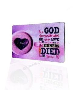 But GOD demonstrates his own love for us - Fridge Magnet